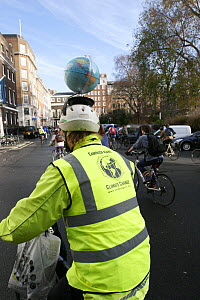 Cyclists, part of 'The Wave' climate change march ahead of the Copenhagen climate summit. Cyclist with globe on cycle helmet, London, UK, 5th December 2009  -  Tom Gilks