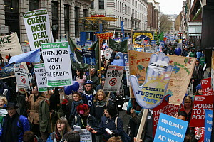 "Protesters carrying signs / banners ""Green jobs won't cost the earth"" and  ""Climate Justice now"", part of 'The Wave' climate change march ahead of the Copenhagen climate summit, London, UK, 5th Decemb... - Tom Gilks"