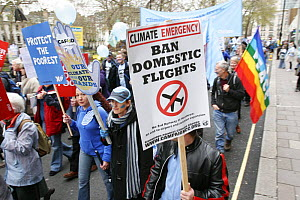 Protesters part of 'The Wave' climate change march ahead of the Copenhagen climate summit, sign stating 'Ban domestic flights' London, UK, 5th December 2009  -  Tom Gilks