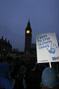 Protesters near Big Ben at dusk, part of 'The Wave' climate change march ahead of the Copenhagen climate summit, signs stating 'I vote to stop climate chaos' London, UK, 5th December 2009  -  Tom Gilks