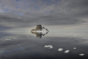 Island with reflection in calm sea, Svalbard, Norway, June 2009  -  Andy Rouse