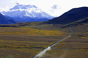 Aerial view of vehicle travelling along road across Denali National Park,  with Mount McKinley in the background, Alaska, USA, autumn, September 2008  -  Jeff Vanuga