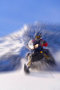 Snowmobiling in the Bridger - Teton National Forest on Togwotee Pass near Dubois, Wyoming. Model released, January 2009 - Jeff Vanuga