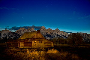 Historic Barn illuminated at night by the light of a full moon, Mormon Row, Grand Teton National Park, Wyoming, USA, May 2009 - Jeff Vanuga