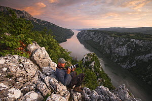 Photographer, Ruben Smit, above the River Danube flowing through the Iron Gate Gorge, on the border between Romania and Serbia, Djerdap National Park, Serbia, June 2009 - Wild Wonders of Europe / Smit