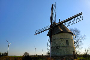 """21st Century wind farm beside restored 17th Century Windmill """"Le moulin Guidon"""", Eaucourt-sur-Somme, France, March 2009  -  Nick Upton"""