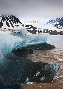 Ice on the coast with low clouds over mountains, Spitsbergen, Svalbard, Norway, June 2009  -  Wild Wonders of Europe / Liodden