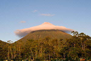 Arenal Volcano with crown of clouds around the summit at sunrise, La Fortuna, Costa Rica, February 2009 - Martin Gabriel