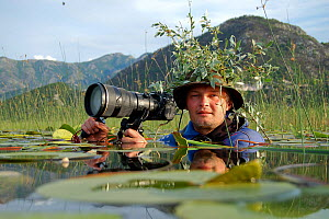 Photographer, Milan Radisics, submerged and camouflaged, in water of Lake Skadar, Lake Skadar National Park, Montenegro, May 2008, on location for Wild Wonders of Europe  WWE BOOK PLATE. WWE OUTDOOR E...  -  Wild Wonders of Europe / Radisic