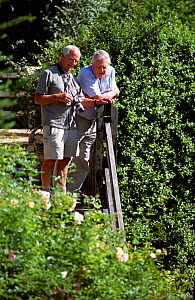 Mike Salisbury and David Attenborough in discussion about a humming-bird hawk moth   sequence for BBC TV production of 'Life in the Undergrowth', Central France. September 2005~Copyright Tom Clarke  -  Mike Salisbury
