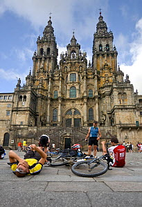 "Bicycle pilgrims resting in front of Santiago de Compostela cathedral, after cycling the Camino de Santiago (""Way of St. James""). Galicia, Spain, July 2008. - Angelo Gandolfi"