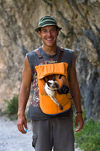 Hiker with a cat in a pouch, Cares Gorge, Picos de Europa National Park, Cantabria, Spain. July 2008. - Angelo Gandolfi
