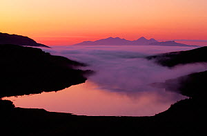 Rum and Eigg from Ardnamurchan Peninsula with incoming sea fog at sunset, Scotland, May - Laurie Campbell