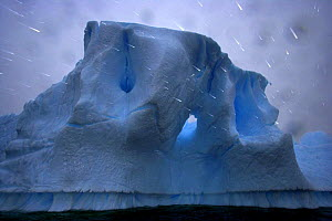 Rain falling in front of iceberg, Antarctica (non-ex)  -  Andy Rouse