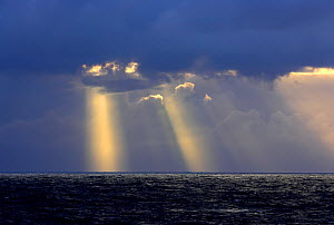 Rays of light shining through storm clouds over Drake Passage, Antarctica, February 2006  -  Andy Rouse