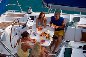 Friends eating breakfast onboard a Sunsail Oceanis 423 in the BVI's, March 2006. Model and property released.  -  Billy Black