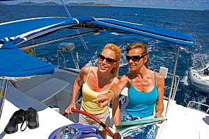 Women helming and navigating onboard a Sunsail Lagoon 410 in the BVI, April 2006. Model and property released.  -  Billy Black