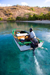 Local fisherman in wooden motorboat off the BVI. April 2006. - Billy Black