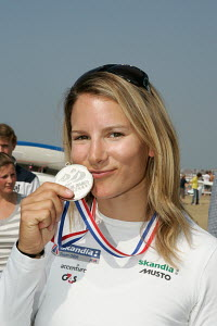 Bryony Shaw (RS:X windsurfing) kissing her silver medal, Skandia Sail For Gold regatta, Weymouth, September 2009.  -  Ingrid Abery
