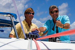 Two men sailing a Sunsail yacht in the British Virgin Islands, March 2006. Model and property released.  -  Billy Black