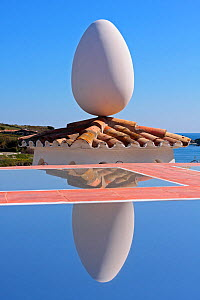 Egg-shaped sculpture balanced on roof and refelected in water at Salvador Dali's House-Museum. Port Lligat, Cap de Creus Natural Park, Gerona, Catalonia, Spain. March 2009.  -  Juan Manuel Borrero
