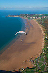 Aerial view of a paraglider over Woolacombe beach, North Devon, UK, October 2009  -  Dan Burton