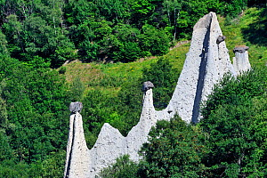 Pyramids of Euseigne, formed by erosion of soft rock below hard rock, Valais, Switzerland, July 2009 - Philippe Clement