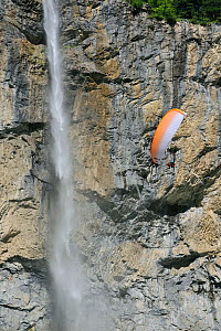 Paraglider flying in front of the 300m high Staubbach Falls, Lauterbrunnen, Bernese Oberland, Switzerland, July 2009 - Philippe Clement