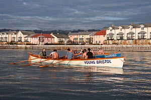 """Cornish Pilot Gigs """"Isambard"""" and """"Young Bristol"""" with men's crews practicing. Bristol Floating Harbour, February 2009. - Merryn Thomas"""