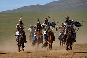 Re-enactement of an attack by the mounted armies of Genghis Khan (emperor of the Mongol Empire) carrying bows and arrows, during the Genghis Khan Show, in Ulaanbaatar, Mongolia. The horses are Mongoli... - Kristel Richard