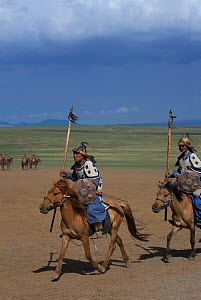 Mounted soldiers from the armies of Genghis Khan (emperor of the Mongol Empire) during the Genghis Khan Show, in Ulaanbaatar, Mongolia. The horses are Mongolian horses. July 2007  -  Kristel Richard