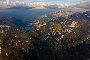 Aerial view of the High Tatras on the Carpathian Mountains, Slovakia-Poland border, Mount Gerlach (2,665m) in the distance, High Tatras, Carpathian Mountains, Slovakia, June 2009  -  Wild Wonders of Europe / D'Amicis