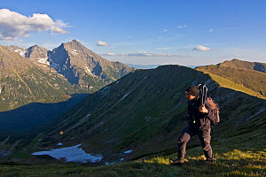 Photographer, Bruno D'Amicis, walking on a ridge, Western Tatras, with Mount Kriv�n (2,495m) in the background, Western Tatras, Carpathian Mountains, Slovakia, June 2009  -  Wild Wonders of Europe / D'Amicis