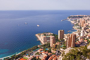 Panoramic view of Montecarlo, the Larvotto Marine Reserve is just in front of the beach covering the small peninsula with the buildings, Larvotto Marine Reserve, Monaco, Mediterranean Sea, July 2009 - Wild Wonders of Europe / Banfi