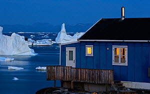 House on the coast with icebergs in the distance, Saqqaq, Greenland, August 2009  -  Wild Wonders of Europe / Jensen