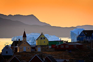 Houses and church in Saqqaq with icebergs on the sea, at sunrise, Disko Bay, Greenland, August 2009  -  Wild Wonders of Europe / Jensen