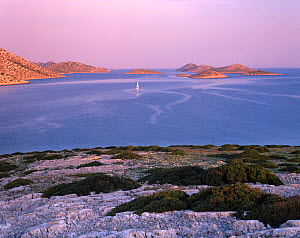 View from Ravni Zakan Island with a small private sailboat on the sea, Kornati National Park, Croatia, May 2009  -  Wild Wonders of Europe / Popp-Hackner