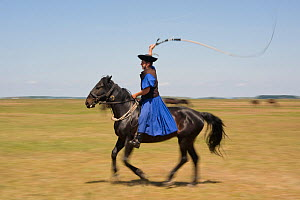 Typical Hungarian herdsman's riding ritual with a whip, Hortobagy National Park, Hungary, May 2009 - Wild Wonders of Europe / Radisics