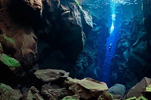 Diver in the tectonic boundary between the Eurasian and the North American plates, Silfra, Thingvellir lake, Thingvellir National Park, Iceland, May 2009  -  Wild Wonders of Europe / Lundgre