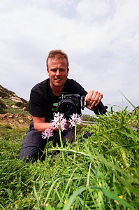 Peter Lilja photographing a Naked man orchid (Orchis italica) in flower, Kayalar, Northern Cyprus, April 2009 - Wild Wonders of Europe / Lilja