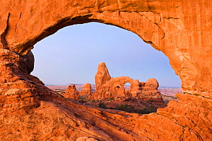 Turret Arch viewed through North Window at dawn, Arches NP, Utah, USA, October 2009 - Rob Tilley