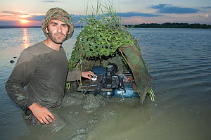 Photographer, Laurent Geslin, in lake with floating hide, Lake Belau, Moldova, June 2009. WWE OUTDOOR EXHIBITION.  -  Wild Wonders of Europe / Geslin