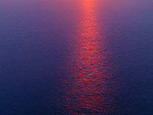 Sun reflected in sea at sunset, viewed from the Cliffs of Moher, County Clare, Ireland, June 2009 - Wild Wonders of Europe / Hermans