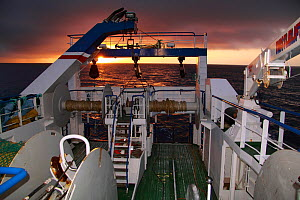 Looking aft onto the trawl deck of a fishing vessel at dusk, December 2009, North Sea.  -  Philip Stephen