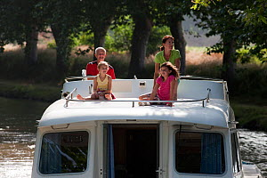 Family cruising on the Canal Du Midi near Aiguille, southern France. July 2009. Model and property released.  -  Billy Black