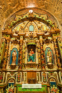 Baroque altar piece in Nativity of Durro Church, romanesque church from XII century, and UNESCO world heritage, in the Bo� Valley, Pyrenees, Lleida, Catalonia, Spain.July 2009 - Inaki Relanzon