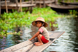 Young boy with a hat, in a traditional boats, Inle Lake, Shan State, Myanmar, Burma. August 2009  -  Inaki Relanzon