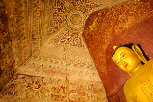 Fresco and Buddha statue inside a temple in Old Bagan, UNESCO World Heritage, Mandalay State, Myanmar, Burma. September 2009 - Inaki Relanzon