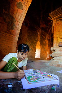 Woman painting souvenirs to sell to tourists at a temple in Old Bagan, UNESCO World Heritage, Mandalay State, Myanmar, Burma. September 2009  -  Inaki Relanzon