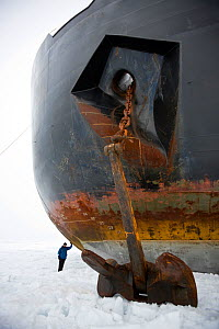 """Woman standing by bow and anchor of Russian nuclear icebreaker, """"NS 50 Let Pobedy"""" 50 years of Victory, North Pole, July 2008 - Doug Allan"""
